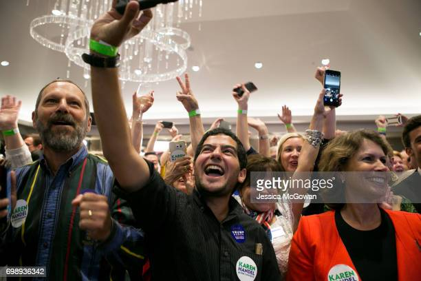 Supporters cheer for early results in favor of Georgia's 6th Congressional district Republican candidate Karen Handel during an election party at the...