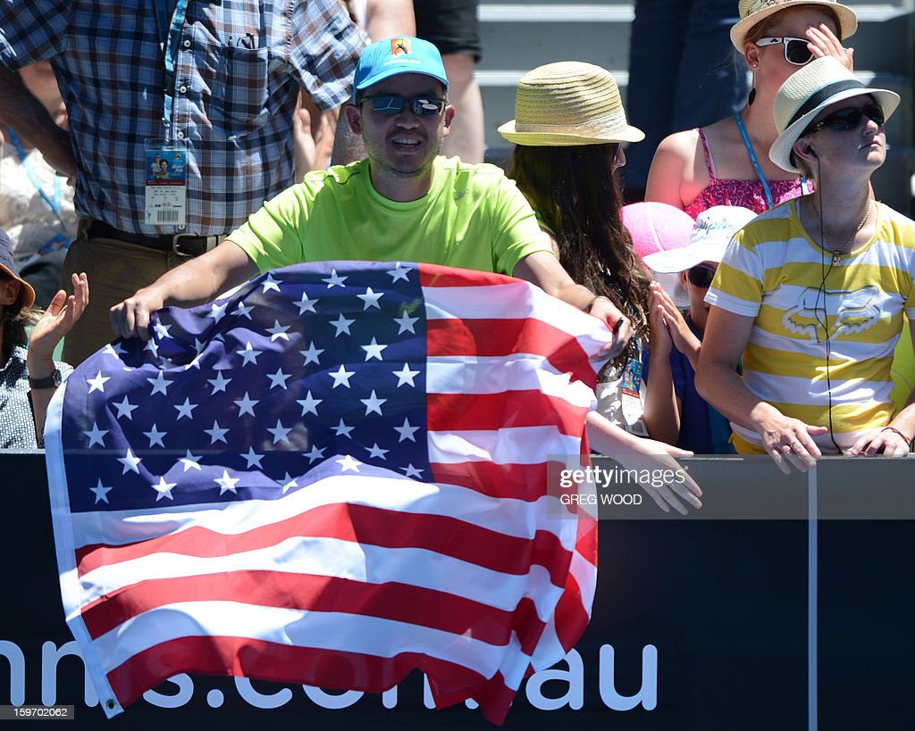 Supporters cheer for Jamie Hampton of the US after defeat in her women's singles match against Belarus's Victoria Azarenka on the sixth day of the Australian Open tennis tournament in Melbourne on January 19, 2013.