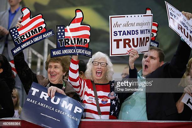 Supporters cheer for presidential candidate and Republican frontrunner Donald Trump during a campaign rally at the Richmond International Raceway...