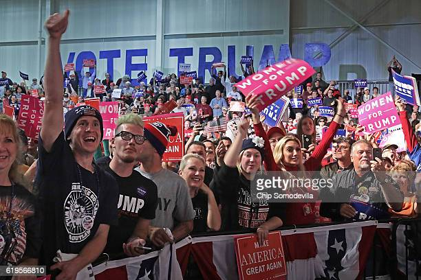 Supporters cheer for Republican presidential nominee Donald Trump during a campaign rally at Macomb Community College South Campus October 31 2016 in...