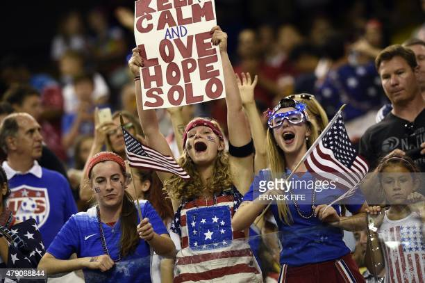 USA supporters cheer for their team ahead of the semifinal football match between USA and Germany during their 2015 FIFA Women's World Cup at the...