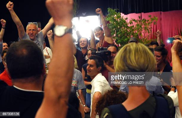 Supporters cheer French film director and journalist candidate for La France Insoumise for the legislative elections Francois Ruffin in Flixecourt...