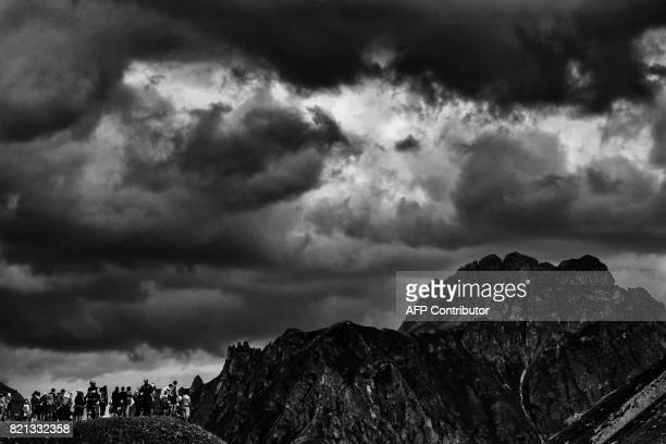Supporters cheer from the top of a hill during the 183 km seventeenth stage of the 104th edition of the Tour de France cycling race on July 19 2017...