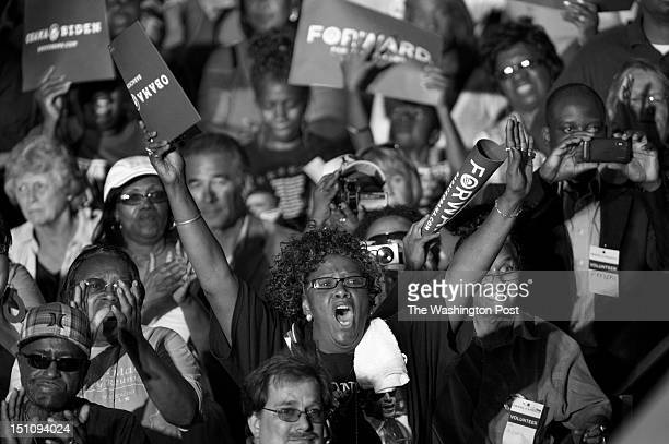 AUGUST 14 Supporters cheer President Barack Obama during his speech along the campaign trail during a stop at RiverLoop Amphitheatre Waterloo Center...