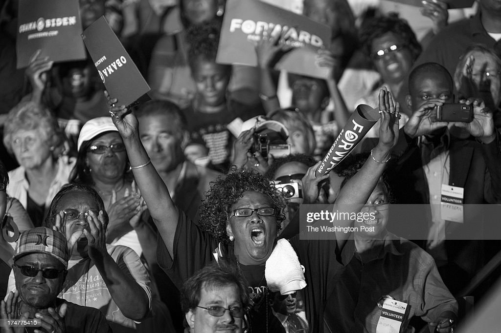 AUGUST 14 -- Supporters cheer President Barack Obama during his speech along the campaign trail during a stop at RiverLoop Amphitheatre, Waterloo Center for the Arts in Waterloo, Iowa, on Tuesday, August 14, 2012.
