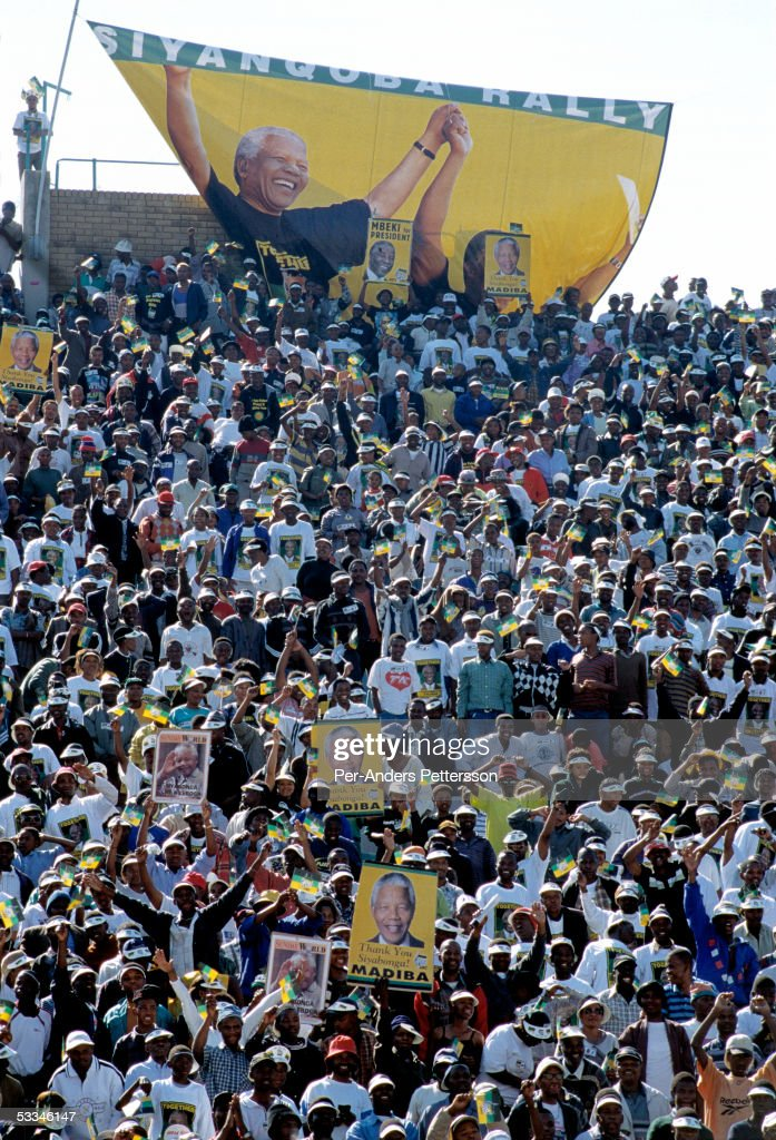 ANC supporters cheer President Nelson Mandela during the start of the election campaign on February 28, 1999 in Soweto, South Africa. About 100.000 people attended the rally that was President Mandelas last election campaign. Mandela retired after one term in 1999 and gave leadership to the current president Mr. Thabo Mbeki.