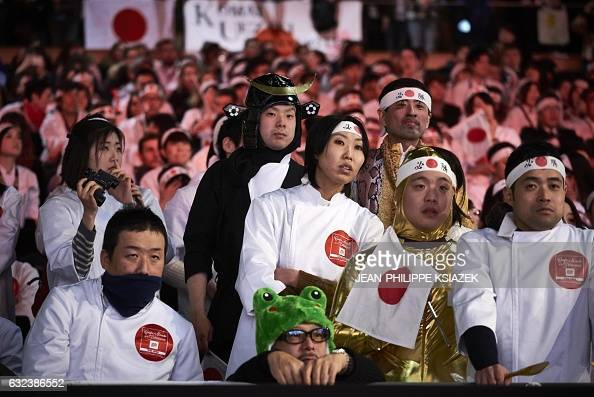 Supporters cheer the Japanese team during the Pastries World Cup final on January 22 2017 in Chassieu outside Lyon as part of the Catering and Food...