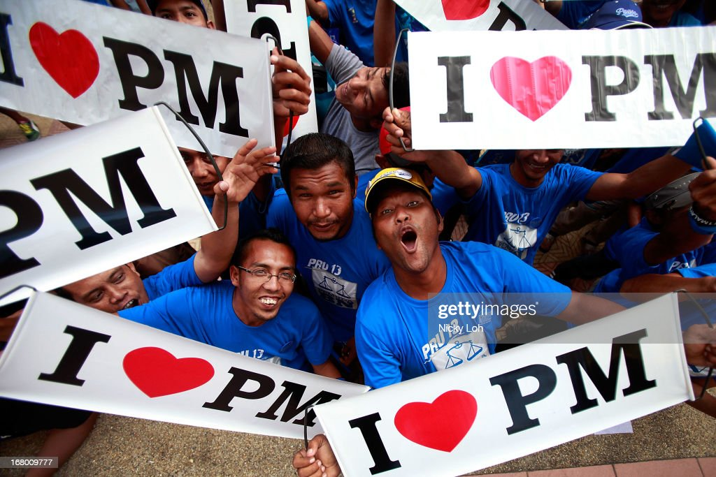 Supporters cheer while waiting for Malaysia's Prime Minister and Barisan Nasional (BN) chairman Najib Razak during an election rally to address young parliamentary constituency voters at his hometown on May 4, 2013 in Pekan, Malaysia. The election, set for May 5, will see incumbent PM Najib Razak face Anwar Ibrahim, whose opposition coalition includes moderates, Islamists and Malaysians of Chinese descent