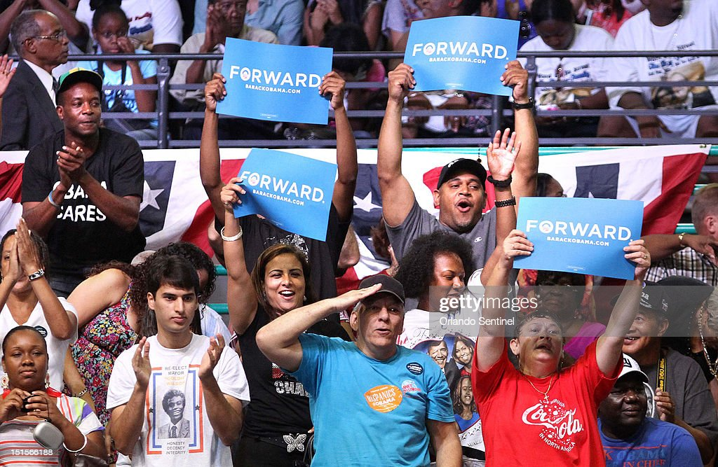 Supporters cheer while waiting for president Barack Obama to arrive at a rally at the Kissimmee Civic Center in Kissimmee Florida Saturday September...