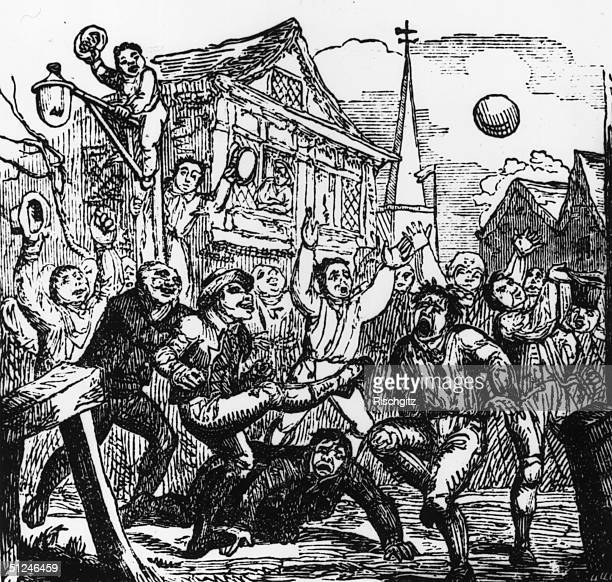 1721 Supporters cheering a group of footballers playing a game on Crowe Street