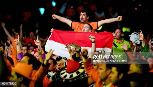 Supporters cheerp up players during a game between Jelle Klaasen of the Netherlands and James Wade during the Premier League Darts in Ahoy Rotterdam...