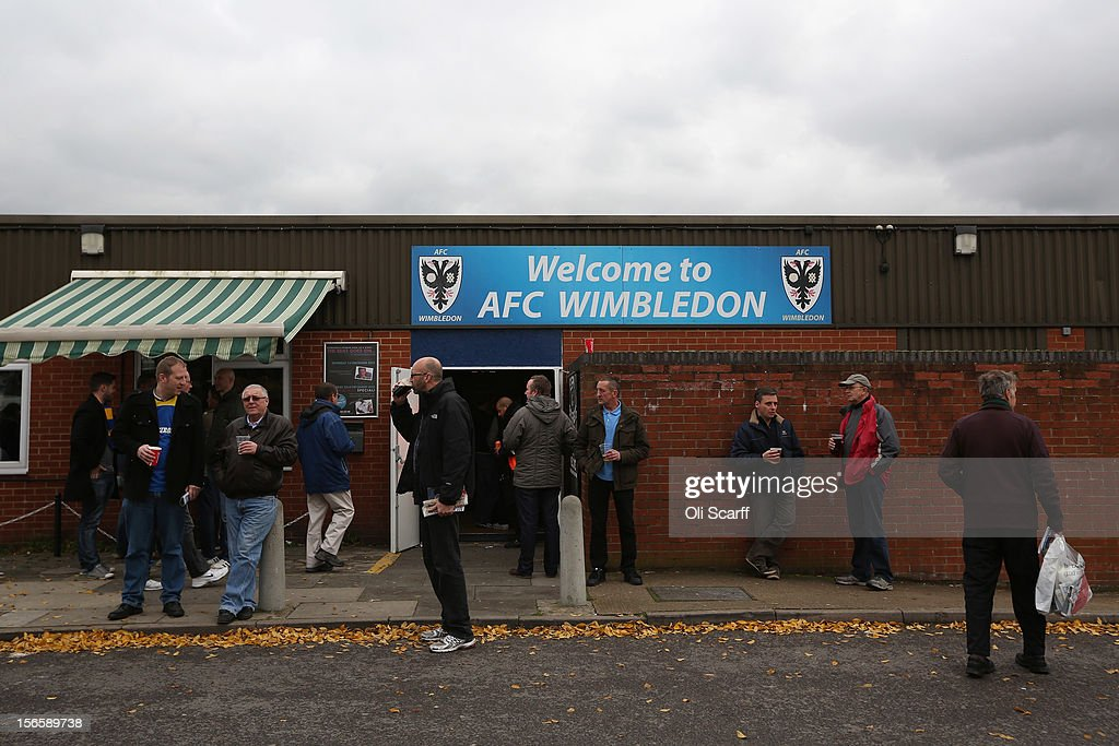 Supporters congregate outside AFC Wimbledon's stadium before the npower League Two match between AFC Wimbledon and Aldershot Town at the Cherry Red Records Stadium on November 17, 2012 in Kingston upon Thames, England. on December 1, 2012 League Two AFC Wimbledon, the football club formed in 2002 by supporters unhappy with their club's relocation to Milton Keynes, will play an FA Cup tie against League One Milton Keynes Dons, which Wimbledon F.C. controversially became.