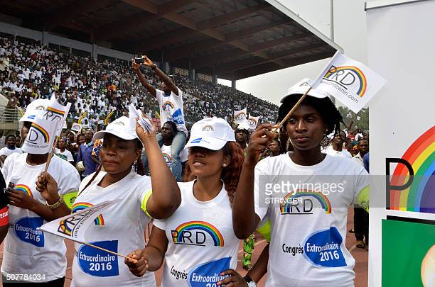 Supporters dance with party flags during a rally as Benin Prime Minister Lionel Zinsou a FrenchBeninese investment banker nominated to fly the FCBE...