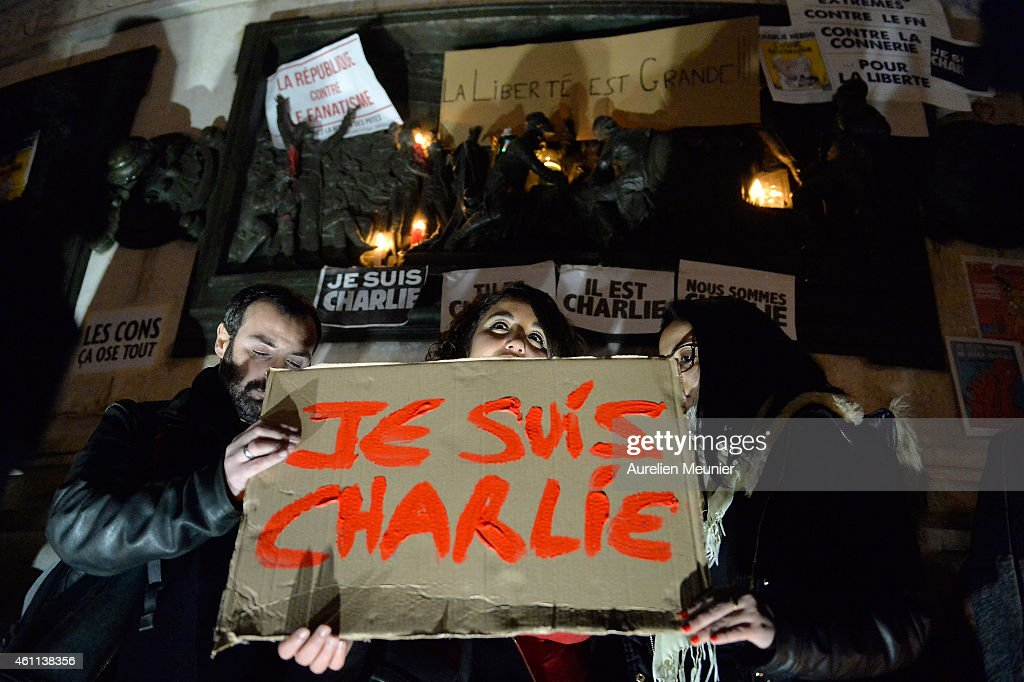 Supporters display placards during a gathering at the Place de la Republique (Republic square) in support of the victims after the terrorist attack earlier today on January 7, 2015 in Paris, France. Twelve people were killed, including two police officers, as two gunmen opened fire at the offices of the French satirical publication Charlie Hebdo.