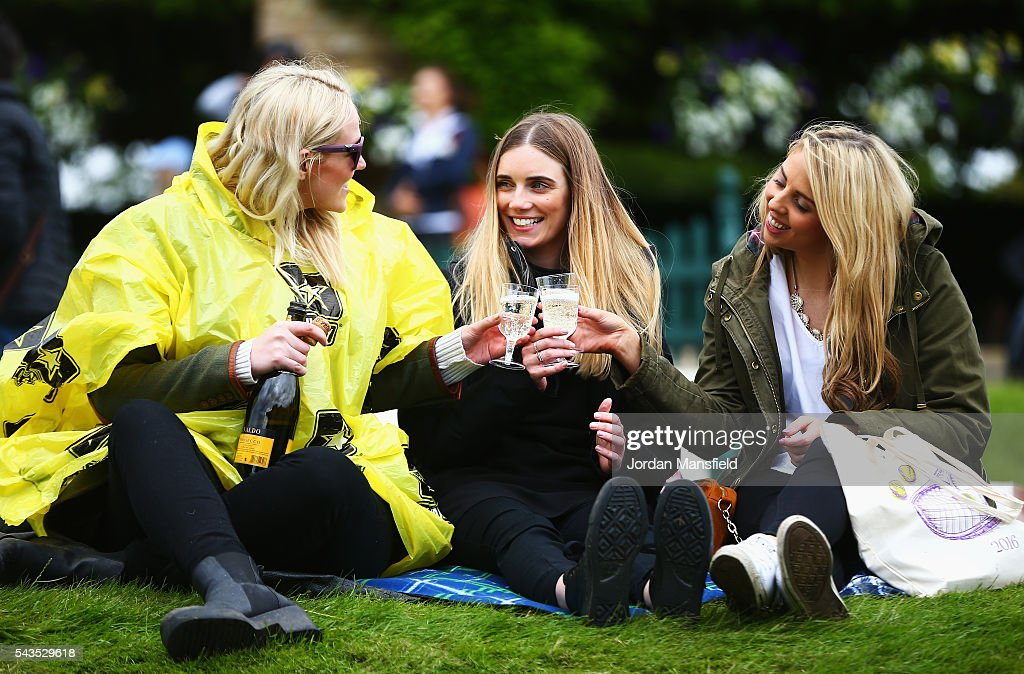 Supporters drinks champaigne on Murray mound prior to day three of the Wimbledon Lawn Tennis Championships at the All England Lawn Tennis and Croquet Club on June 29, 2016 in London, England.