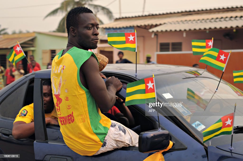 Supporters drive their car on February 3, 2013 in Lome before watching the African Cup of Nation 2013 quarter final football match between Burkina Faso and Togo, later today in Nelspruit, South Africa. AFP PHOTO / Daniel Hayduk