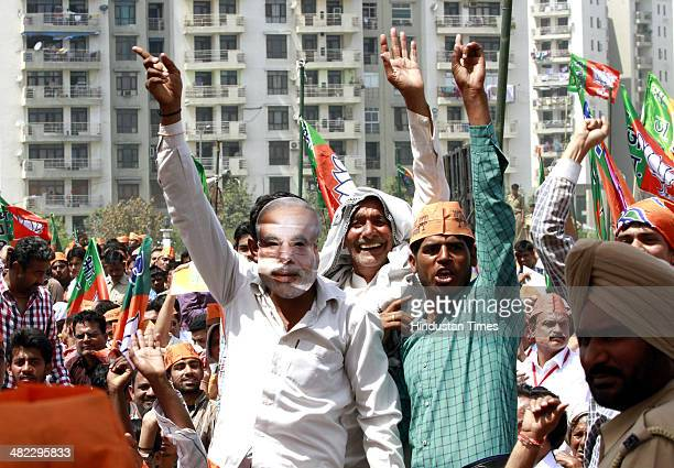 BJP supporters during a rally by BJP Prime Ministerial candidate Narendra Modi in the support of Ghaziabad candidate and former Indian Army Chief VK...