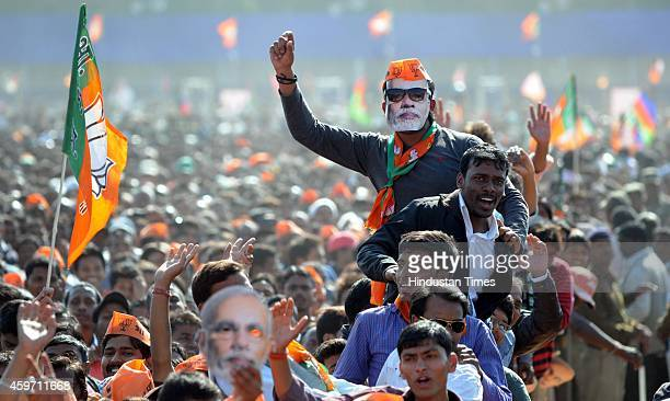 BJP supporters during an election rally of Prime Minister Narendra Modi at Morhabadi ground on November 29 2014 in Ranchi India Modi seemed to...