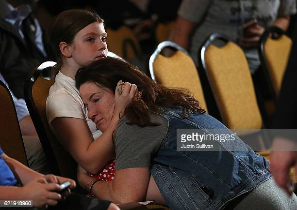 Supporters embrace as they wait Former Secretary of State Hillary Clinton to deliver remarks to supporters and staff at the New Yorker Hotel on...