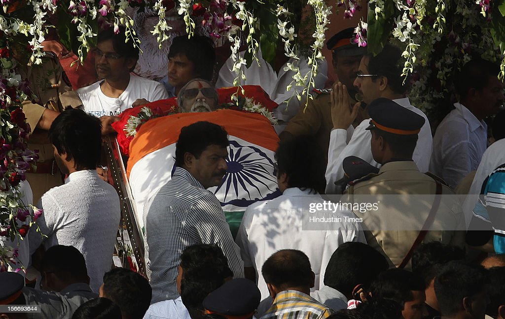 Supporters follow the funeral cortege of Indian Hindu nationalist Shiv Sena party leader Bal Thackeray on November 18, 2012 in Mumbai, India. Bal Thackeray passed away on November 17, 2012 at the age of 86 years.