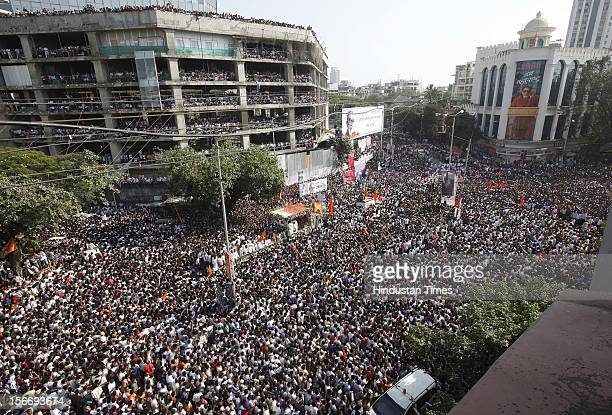 Supporters follow the funeral cortege of Indian Hindu nationalist Shiv Sena party leader Bal Thackeray on November 18 2012 in Mumbai India Bal...