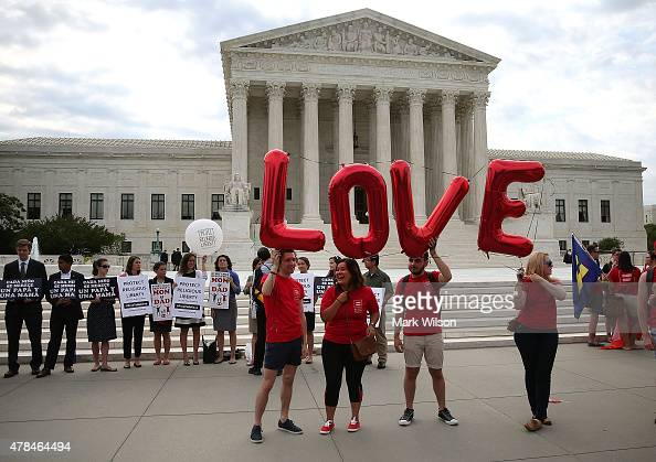 Supporters for and against gay marriage gather in front of the Supreme Court Building June 25 2015 in Washington DC The high court is expected rule...