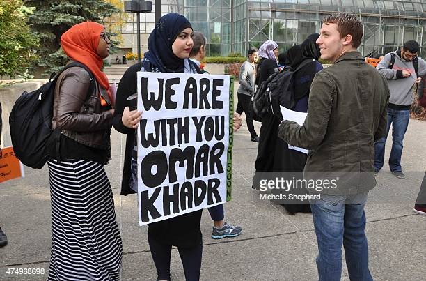 Supporters for former Guantanamo detainee Omar Khadr hold a rally outside an Edmonton courtroom Sept 23 2013 The 27yearold appeared for the first...