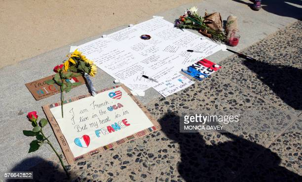 TOPSHOT Supporters for the victims of the attack in Nice France leave flowers and notes during a vigil and moment of silence in San Francisco...
