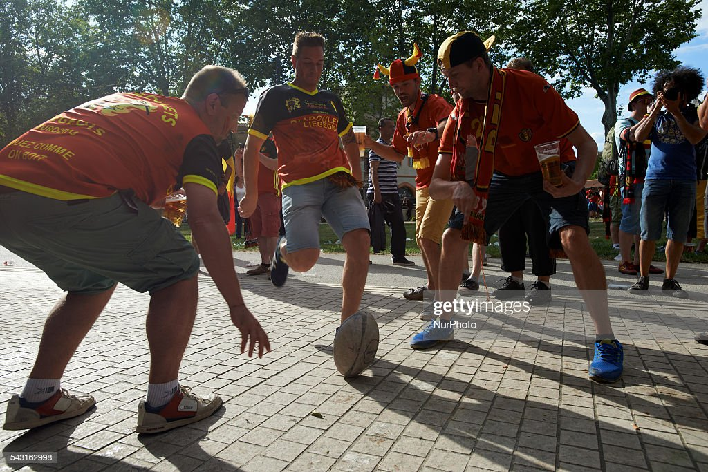 Supporters from Belgium play rugby before the match between Hungary and Belgium. Supporters from Belgium and Hungary came to Toulouse and its Municipal stadium for the round of 16 of the EUFA Euro 2016 football championship. Toulouse, France on June 26th, 2016.