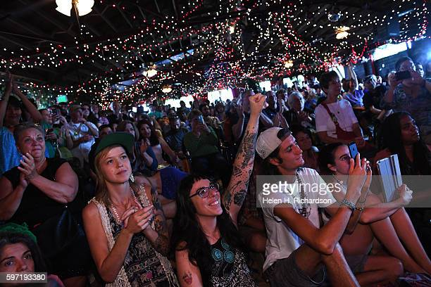 Supporters from left to right Dome Betz Michele Zampillo Connor Ryan and Erin Dougherty listen to Green party candidate Jill Stein reflected in a...