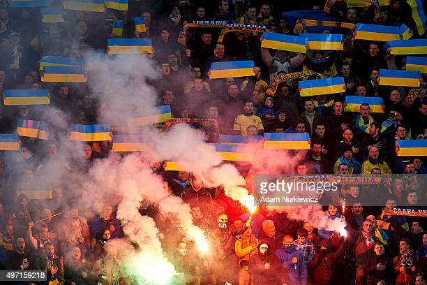Supporters from Ukraine light fireworks during the UEFA EURO 2016 Playoff for Final Tournament First leg between Ukraine and Slovenia at Lviv Arena...
