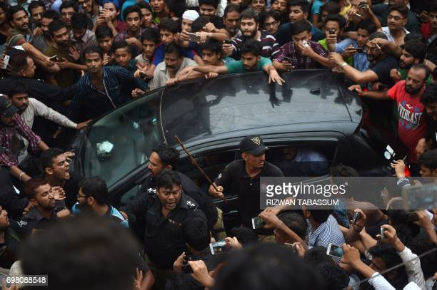 Supporters gather around the vehicle carrying Pakistan 's cricket captain Sarfaraz Ahmed upon his arrival from London in Karachi on June 20 after...