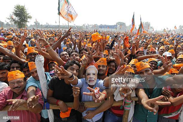 BJP supporters gather during an election rally of Prime Minister Narendra Modi amid Bihar Assembly Elections at Hazipur on October 25 2015 in Patna...