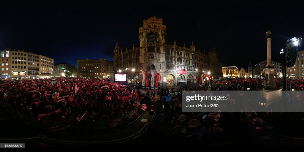 Supporters gather in front of the town hall as Bayern Muenchen celebrate winning the German Bundesliga title at Marienplatz on May 11, 2013 in Munich, Germany.
