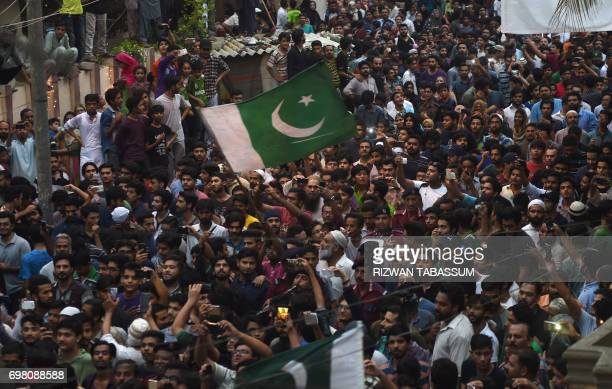Supporters gather outside the residence of Pakistan 's cricket captain Sarfaraz Ahmed upon his arrival from London in Karachi on June 20 after...