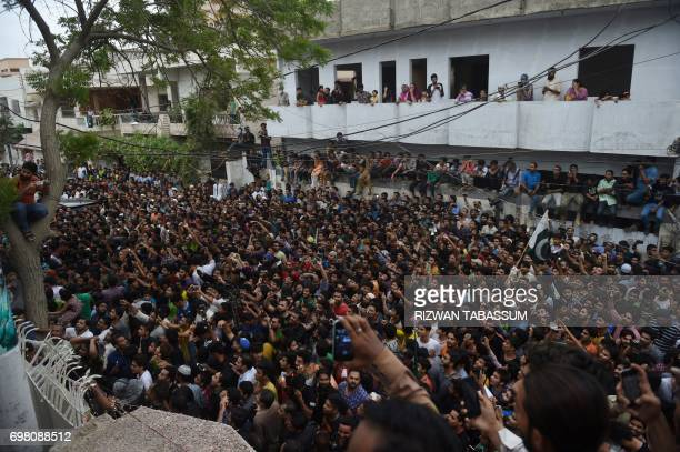 Supporters gather outside the residence of Pakistan's cricket captain Sarfaraz Ahmed upon his arrival from London in Karachi on June 20 after...