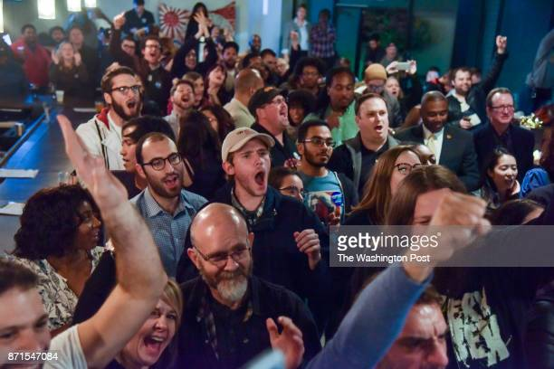 Supporters gather to celebrate a win by Danica Roem who ran for house of delegates against GOP incumbent Robert Marshall at Water's End Brewery on...