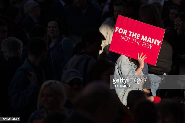 Supporters gather to listen to Britain's opposition Labour Party Leader Jeremy Corbyn addresses supporters in Manchester in north west England on May...