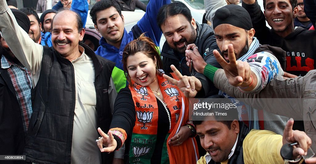BJP supporters gesture after good results in assembly polls outside their party headquarters on December 23 2014 in Jammu India PDP emerged as single...