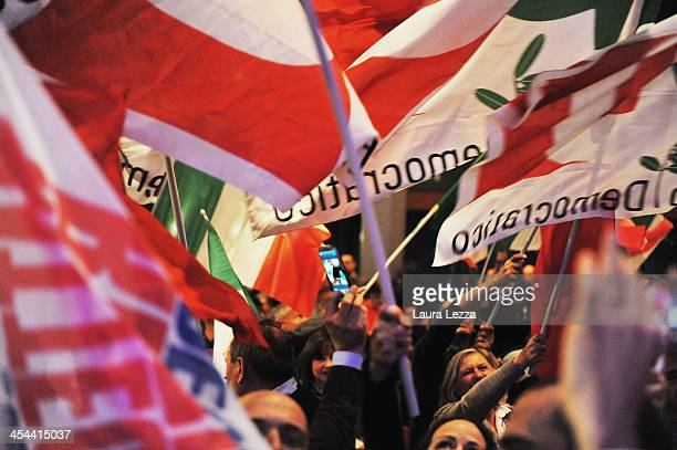 Supporters greet Mayor of Florence Matteo Renzi during his speech after his election as Italian new leader of the centreleft PD after primary...