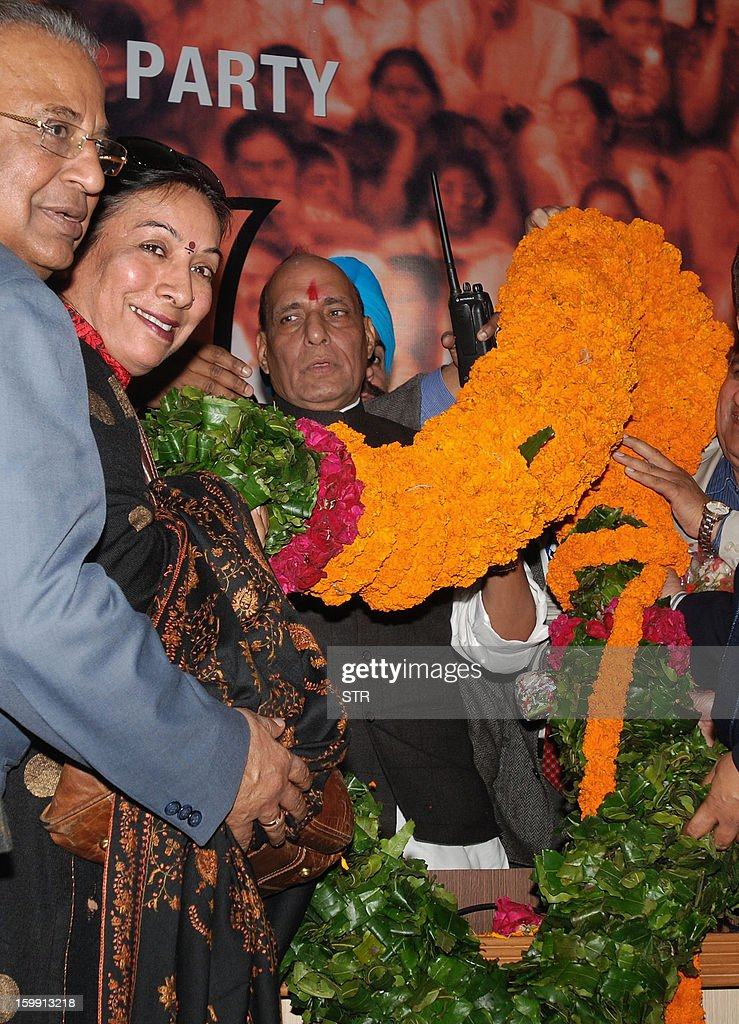 Supporters greet newly-elected main opposition Bharatiya Janata Party (BJP) president Rajnath Singh (R) during an election in New Delhi on January 23, 2013. BJP elected a new leader on Wednesday after the scandal-tainted incumbent resigned abruptly following a corruption scandal just over a year before national elections. Nitin Gadkari, president of the Hindu nationalist BJP since 2009, stepped down late on Tuesday over a probe into alleged misuse of funds for irrigation work in the western state of Maharashtra.