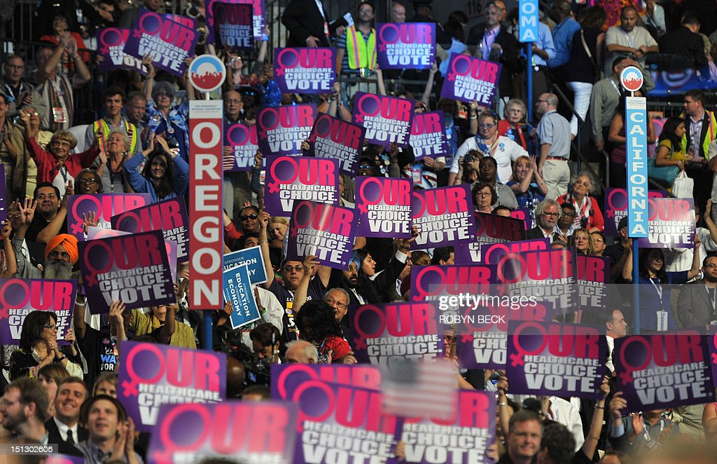 Supporters hoist signs as the President of Planned Parenthood Action Fund Cecile Richards speaks to the audience at the Time Warner Cable Arena in...