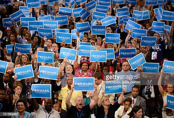 Supporters hoist signs reading 'Forward' as US President Barack Obama states his acceptance to run for a second term as president at the Time Warner...
