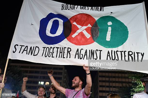 'NO' supporters hold a banner reading 'NO' in front of the parliament late in Athens on July 5 2015 Greece's Prime Minister Alexis Tsipras said that...