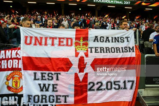 Supporters hold a banner reading 'United against terrorism Lest we forget 220517' in memory of recent Manchester Arena terrorist attack victims...