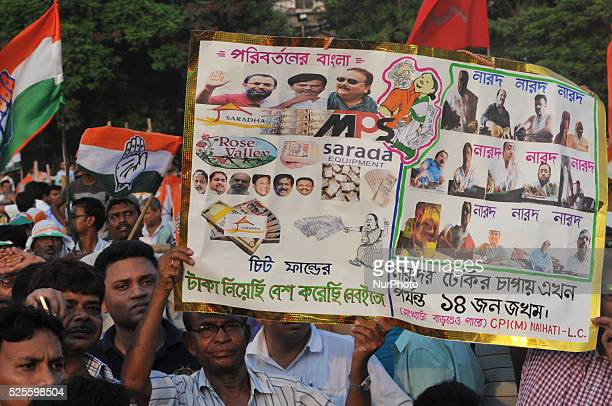 Supporters hold a poster during Congress Vice President Rahul Gandhi and CPI veteran and former Chief Minister Buddhadeb Bhattacharjee during a joint...