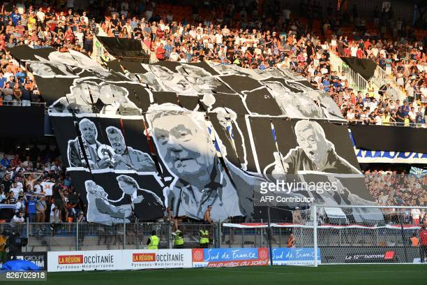 Supporters hold banners in tribute to Montpellier's late president Louis Nicollin prior to the French L1 football match between Montpellier and Caen...