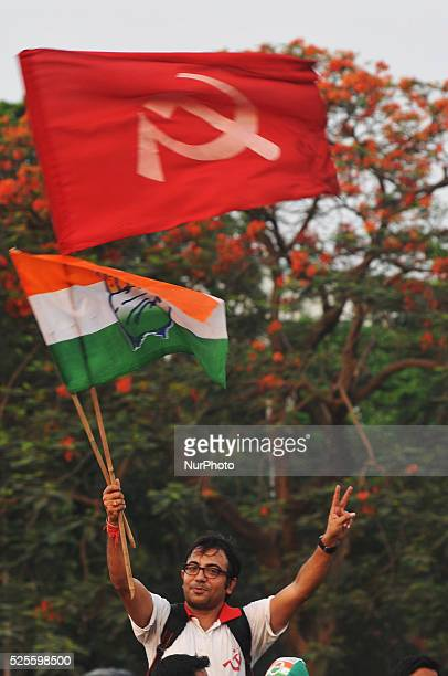 Supporters hold Congress and CPI Party Flag during Congress Vice President Rahul Gandhi and CPI veteran and former Chief Minister Buddhadeb...