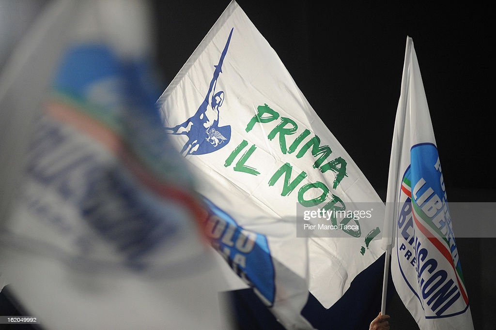 Supporters hold flags of the Popolo della Liberta and Lega North parties during a political rally on February 18, 2013 in Milan, Italy. Berlusconi is entering the last week of campaigning for his party Popolo della Liberta. Italians go to the polls February 24-25.