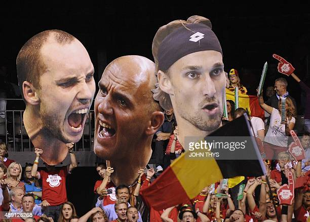 Supporters hold giant pictures of players of the Belgian tennis team Steve Darcis Ruben Bemelmans Johan Van Herck during the Davis cup semifinal...